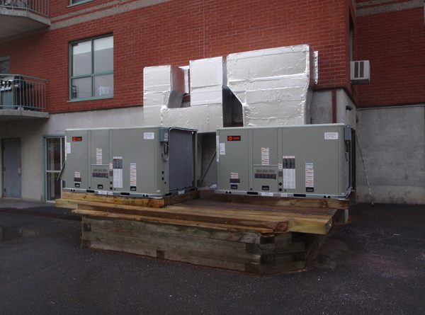 We replaced the roof tops with 2 new Trane Roof top units and cleaned up the site for easier service