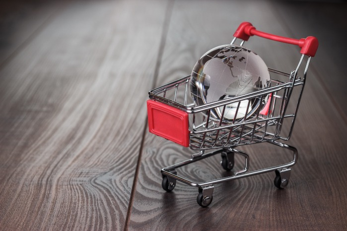 clear sphere in a miniature shopping cart